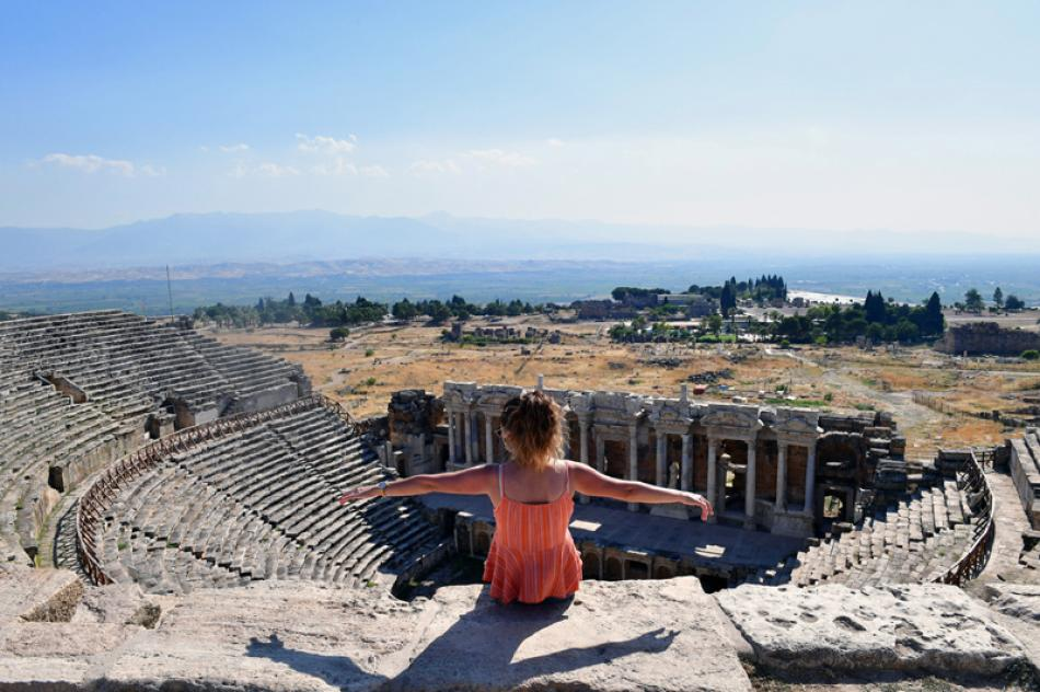 Images of the Day:A visitor sits on the ruins of the ancient city of Hierapolis in Turkey.