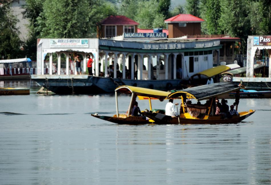 Tourists taking a shikara ride in Srinagar's Dal L ...